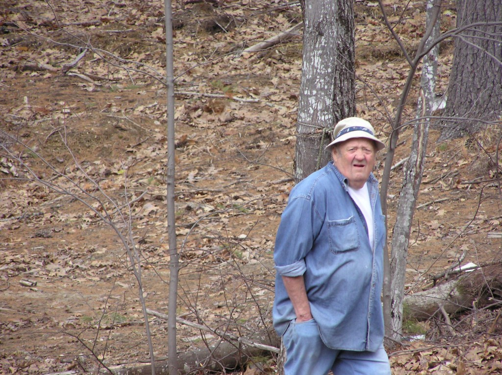 "Edgar ""Teddy"" Dyer walks in the woods, where he would often pick fiddleheads, dandelion greens and pussy willows for those he knew enjoyed them."