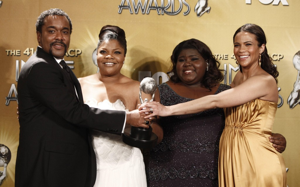 "From left, Lee Daniels, Mo'Nique, Gabourey Sidibe and Paula Patton pose with the award for outstanding motion picture for ""Precious"" at the 41st NAACP Image Awards."