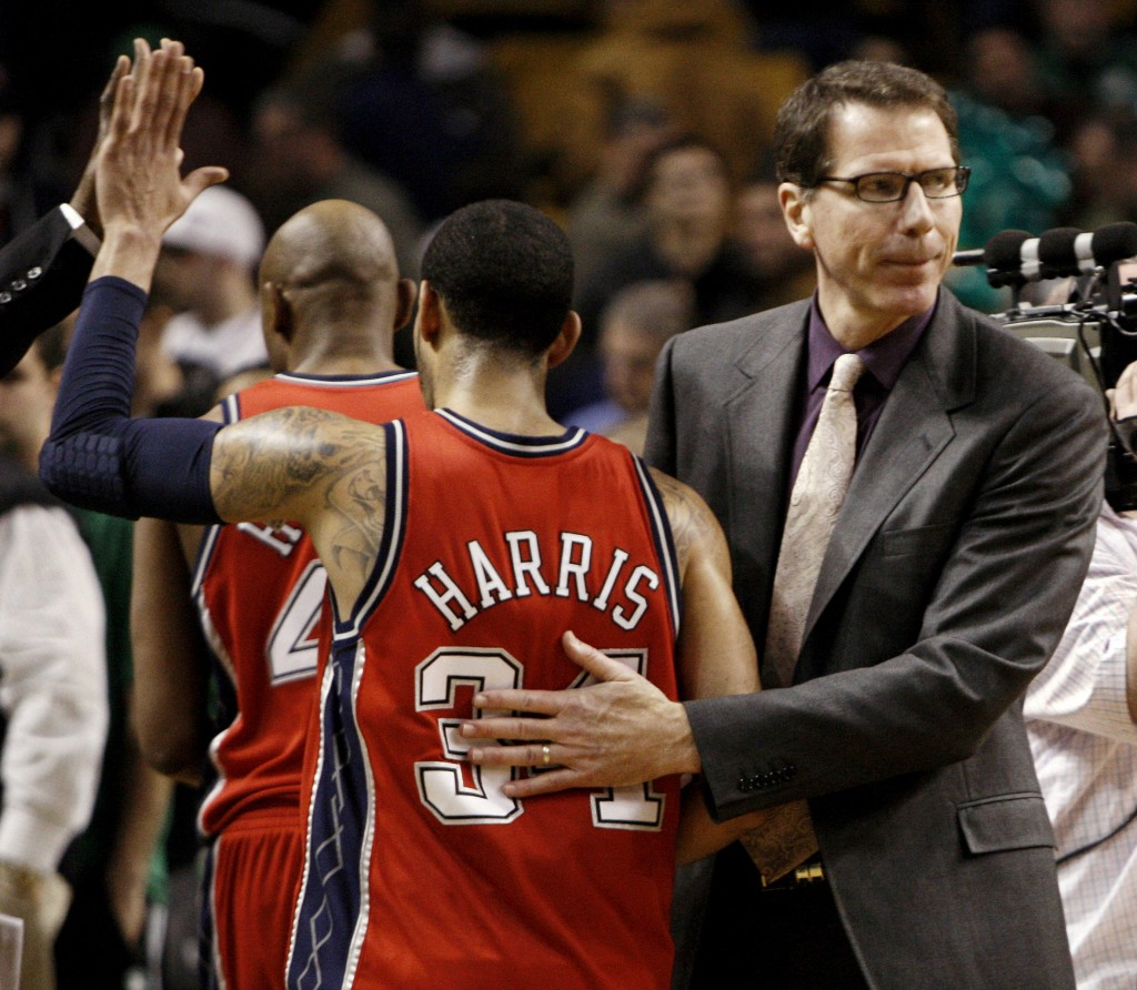 "New Jersey's Devin Harris, left, is congratulated by Coach Kiki Vandeweghe on Saturday in Boston as the Nets knocked off the Celtics 104-96. Vandeweghe said, ""Any win is big for us."""
