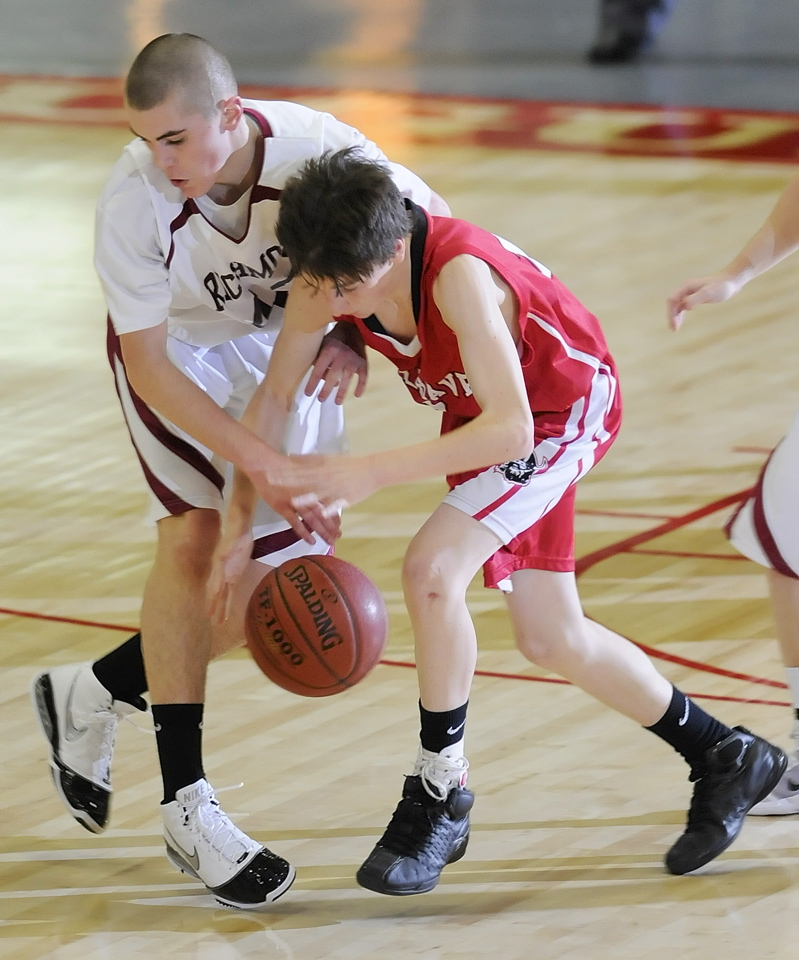 Thomas Carter, left, of Richmond battles for a loose ball with Brian Stanley.