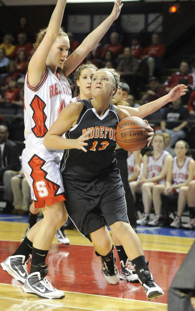 Keila Grigware of Biddeford drives the baseline against Christy Manning.
