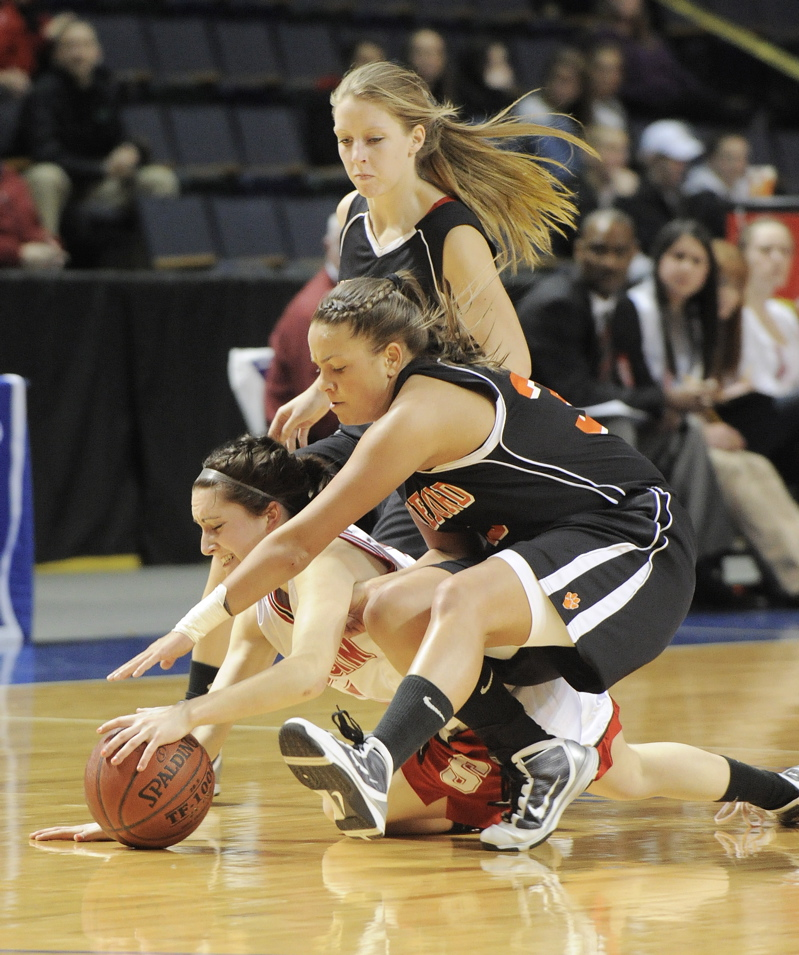 Scarborough's Brittany Ross, bottom, and Lauren Rousseau of Biddeford chase a loose ball along with Biddeford's Jacklyn McCurry.