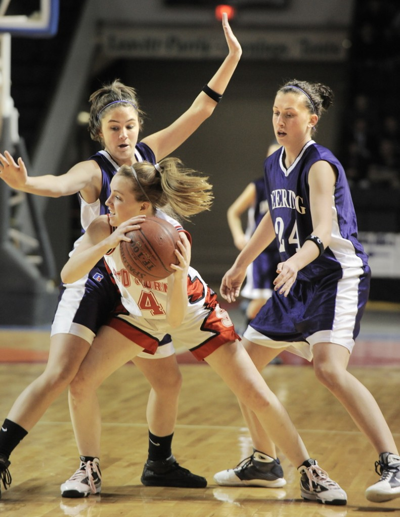 Heather Carrier of Scarborough looks for help while guarded by Maria Salamone, left, and Ella Ramonas of Deering.