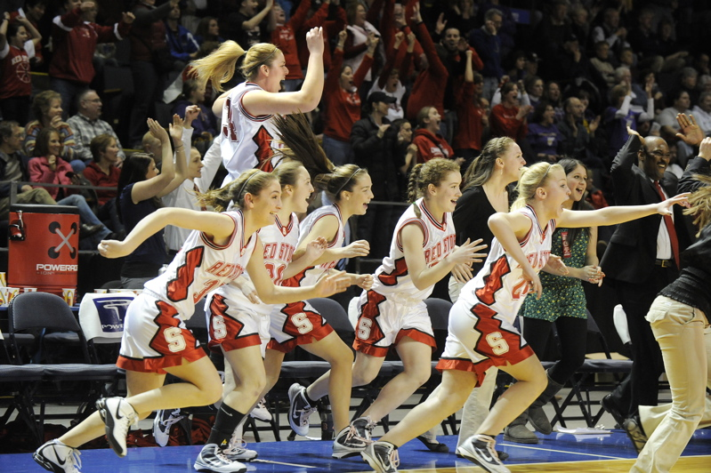 Scarborough players rush onto the court following their come-from-behind win over Deering.