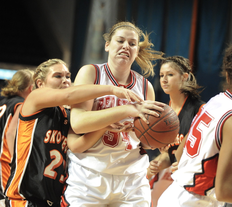 Scarborough's Brittany Bona pulls a rebound away from Jaimi Poland.