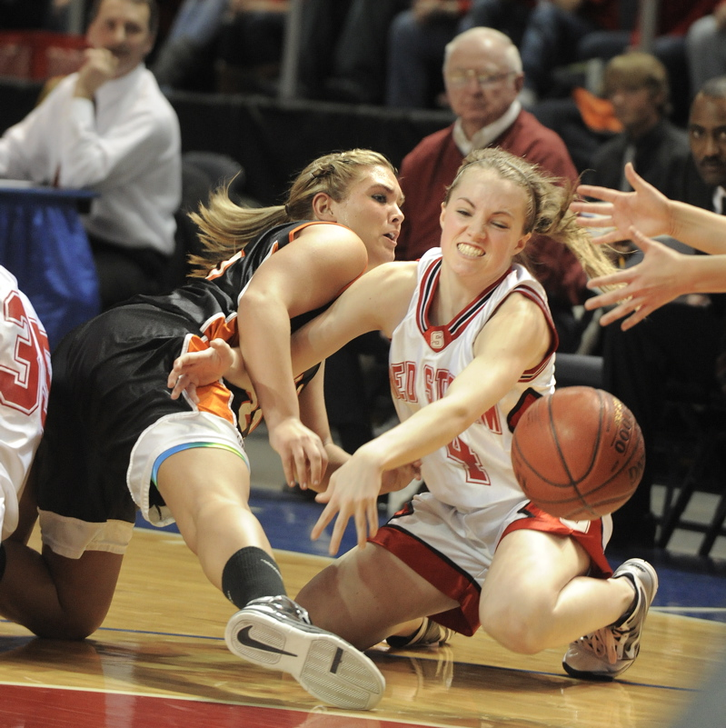 Heather Carrier, right, of Scarborough and Jaimi Poland of Skowhegan scramble to recover a loose ball during Scarborough's 52-32 victory in the Class A final.