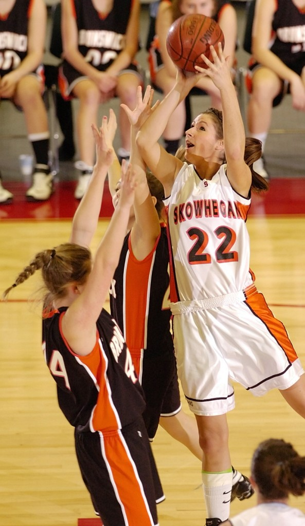 Mackenzie Smith of Skowhegan shoots over Emily Bryant, left, and Becky Champagne.