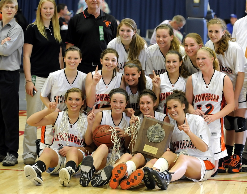 Skowhegan players pose with their championship plaque after winning the Eastern Class A title.