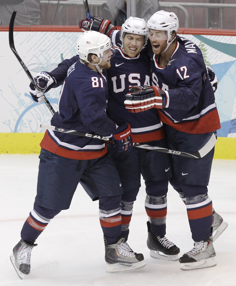 Ryan Malone, right, celebrates with Phil Kessel, left, and Joe Pavelski after scoring the opening goal Friday for the U.S. in a 6-1 semifinal victory over Finland.