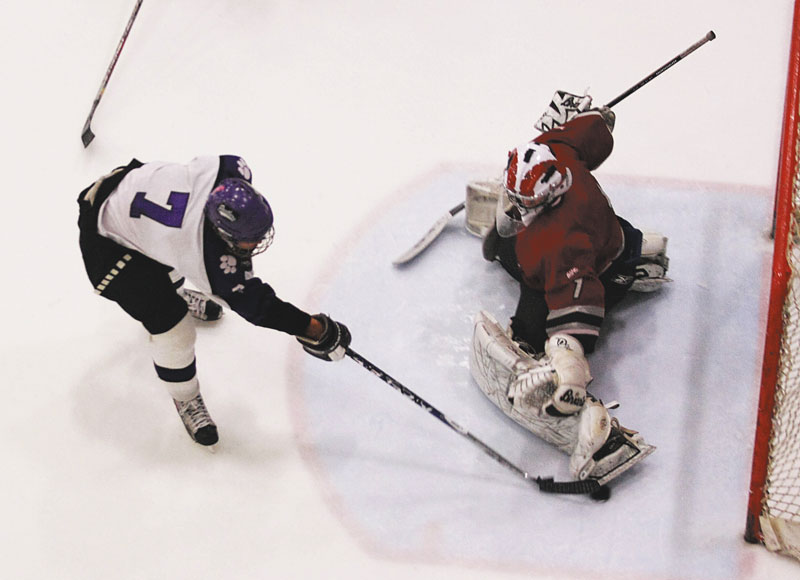 Photo by Jeff Pouland SEEING THE GOAL: Josh Gaudette scores one of Waterville's five third-period goals during against Bangor during a 7-2 victory in an Eastern Maine Class A seminfinal Saturday in Lewiston.
