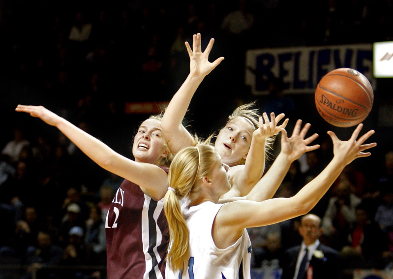 Andrea Mountford of York pulls in a rebound alongside teammate Nicole Taylor and Greely's Abby Young during the Western Class B championship game at the Cumberland County Civic Center. York won, 50-38.