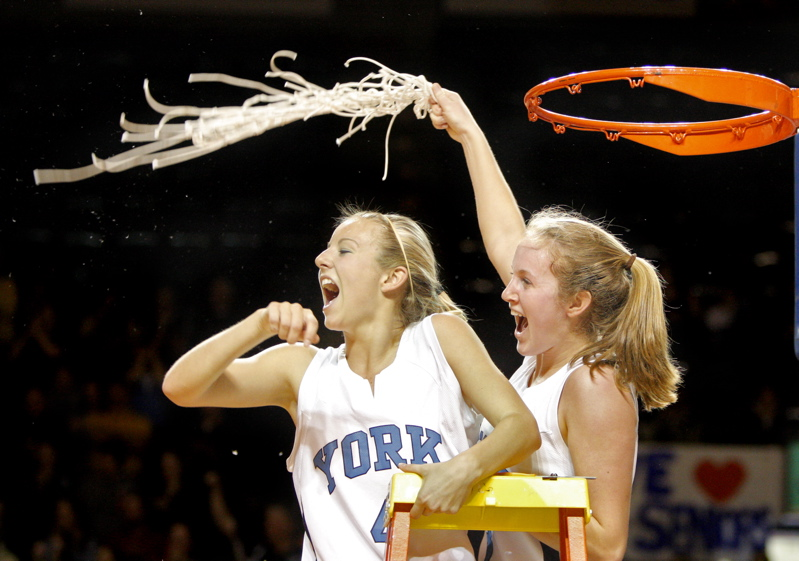 Stephanie Gallagher, left, and Emma Clark celebrate York's second straight regional title. The Wildcats will play Nokomis for the state championship on Friday in Bangor.