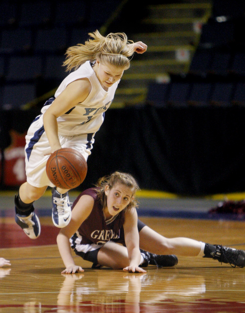 Amdrea Mountford of York trips over Nicole Faietta while chasing a loose ball.