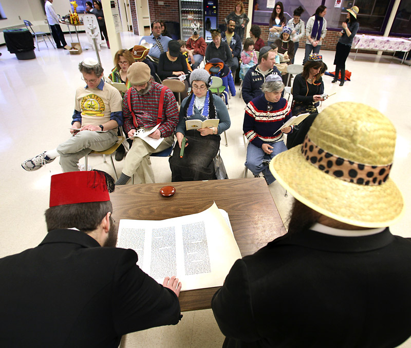 Yossi Freidman, left, and Rabbi Moshe Wilansky begin the celebration with the Megilah reading, which tells the story of Purim.