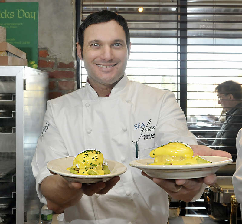 Chef Mitchell Kaldrovich of the Sea Glass Restaurant at the Inn by the Sea in Cape Elizabeth offers his creation, crab Benedict, to guests at the breakfast cook-off.