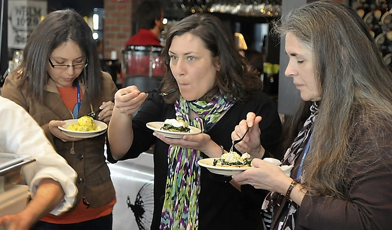 Frances Mercado, left, Kristin Rieff and Elena Schmidt, all staff members at Preble Street social service agency, enjoy entries by the Port Hole and Sea Glass restaurants on Friday at the Incredible Breakfast Cook-Off at the Sea Dog Brewing Co.