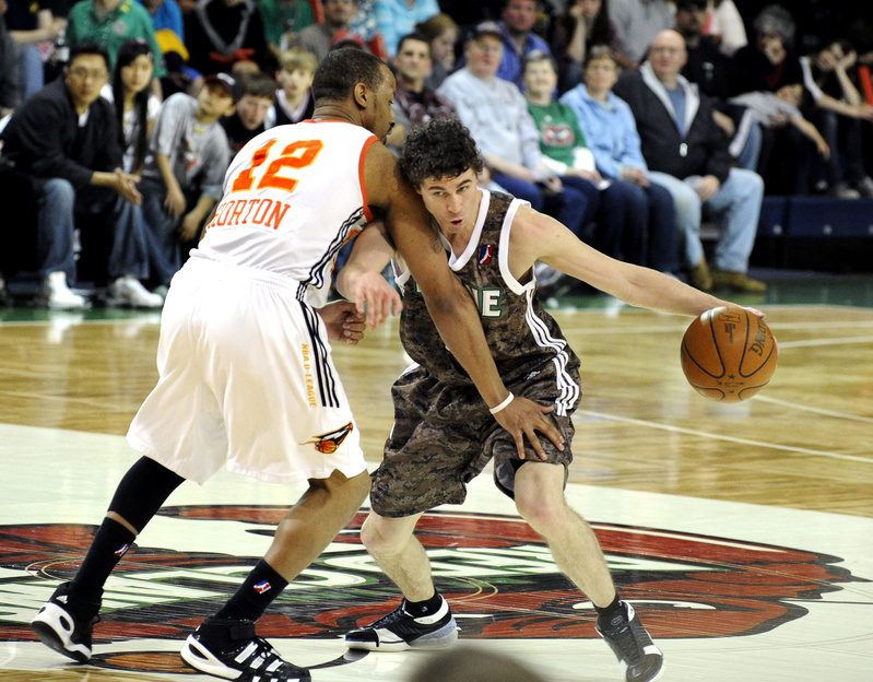 Brock Gillespie, who joined the Red Claws on Friday after spending most of the season in Finland, then Lebanon, drives on Jason Horton of the Albuquerque Thunderbirds.