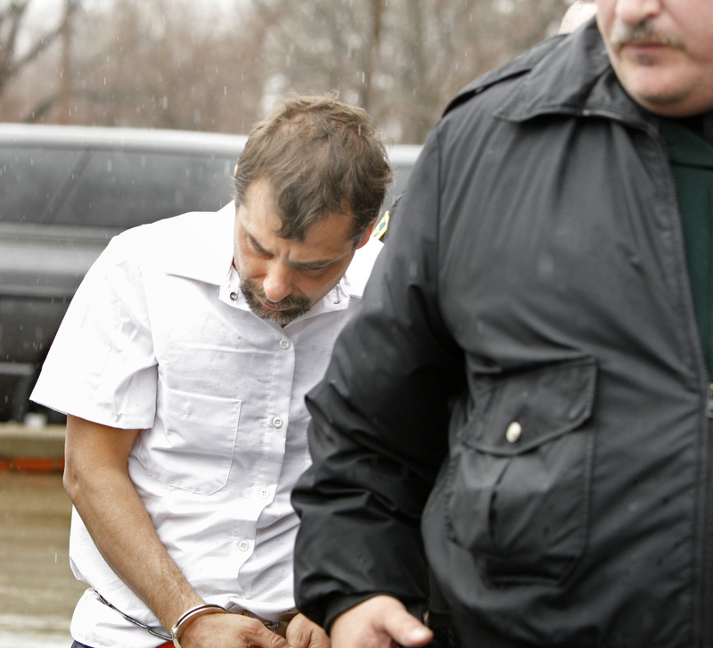Patrick Dapolito, charged with murdering his wife at their Limington home, is led from court Monday in Alfred.