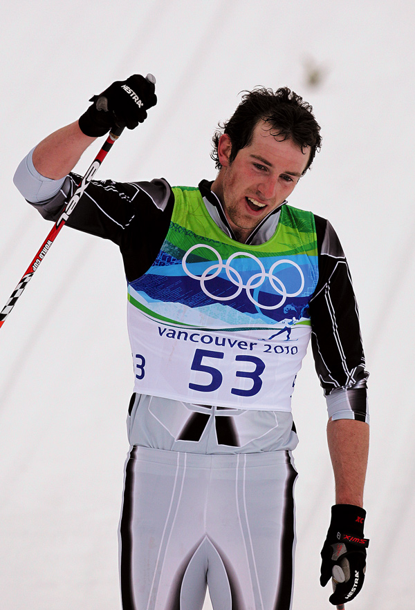 Ben Koons, a Messalonskee High graduate representing his native New Zealand, makes it to the finish line in the men's 50-kilometer mass start cross country ski race.