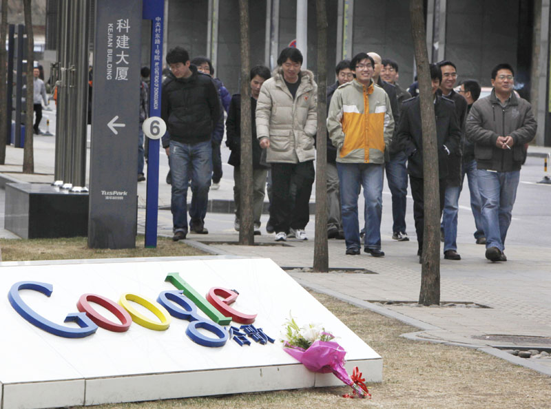 A bouquet of flowers rests on the Google logo outside the Google China headquarters in Beijing today.