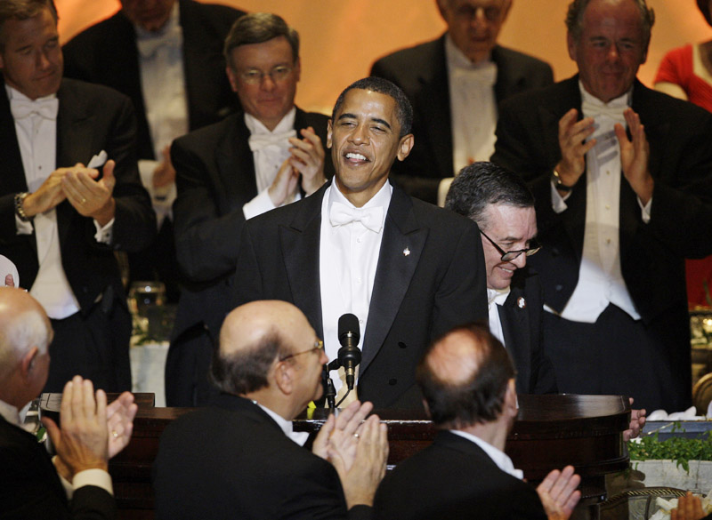 "In this 2008 file photo then-presidential candidate Sen. Barack Obama is applauded as he speak during the Alfred E. Smith Dinner at the Waldorf Astoria Hotel in New York. Obama had them in stitches with a sendup of his fawning treatment by the national media. ""Contrary to the rumors you have heard, I was not born in a manger,"" he said. ""I was actually born on Krypton and sent here by my father Jor-El to save the Planet Earth."""