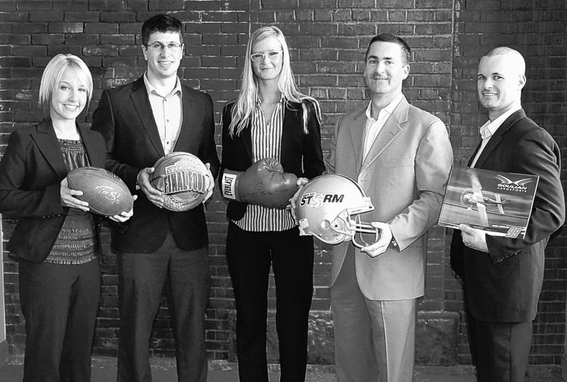 The teamat Shamrock Sports Group, a sports marketing firm on Commercial Street in Portland, includes, from left, Jennilee Keef, Matthew Burgess, Diana Arnold, Brian Corcoran and Court Barnett.