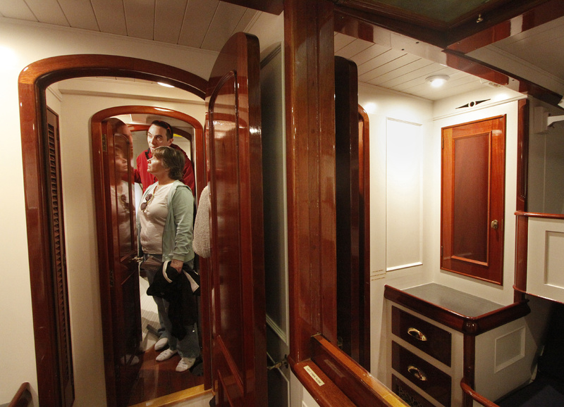 Brian and Liz LaPoint of Rochester, N.H., stroll through the living quarters of the Alden Schooner Lion's Whelp, designed and built by Phineas Sprague.