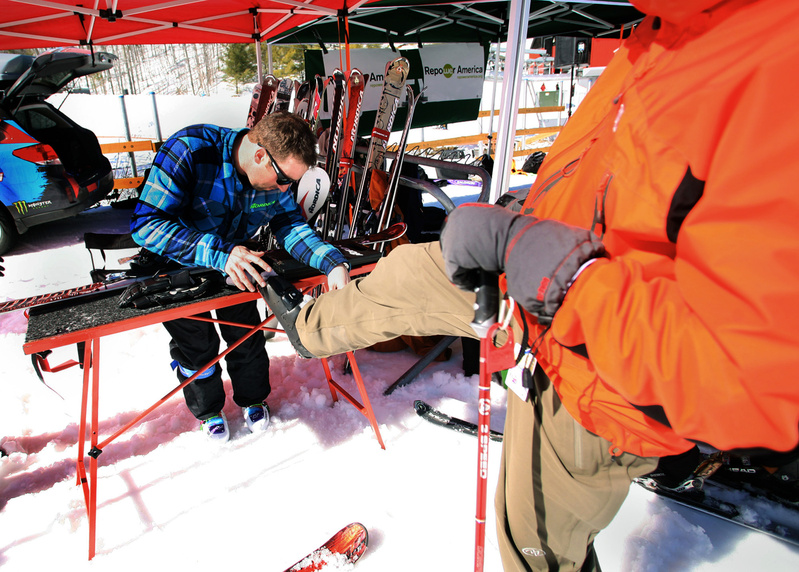 Greg Sutcliffe of Nordica checks the length of Scott Rudel's boot as he sets the binding pressure on skis for Rudel to take for a test run down the slopes.