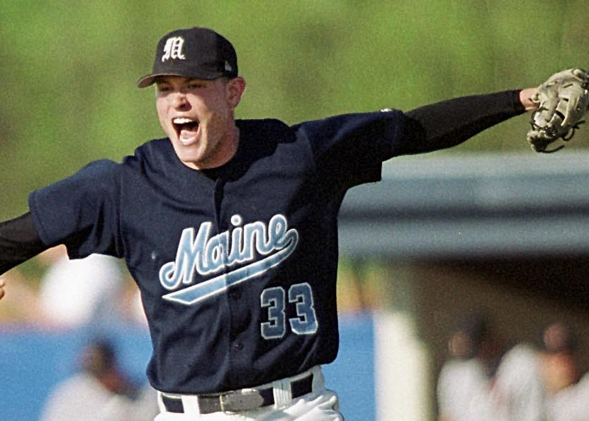 AP File Photo | Maine closing pitcher Mike Collar (33) rejoices in 2002, in Orono,