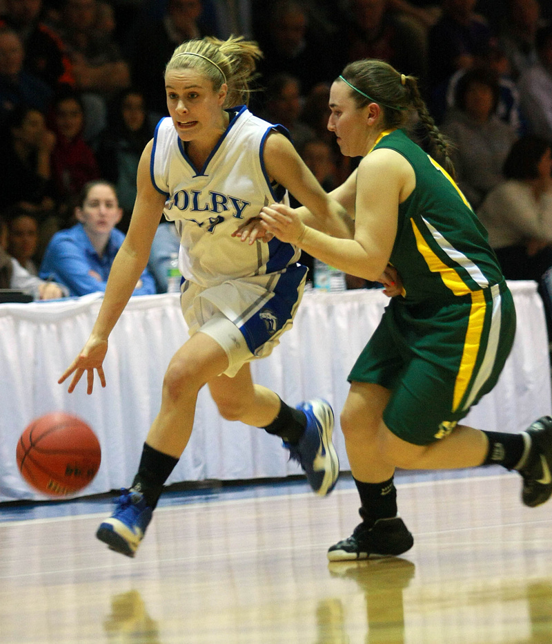 Diana Manduca of Colby, the former Deering High standout, dribbles past Caitlyn Butterfield of Husson during their NCAA Division III tournament game Friday night. Colby came away with a 62-59 victory at home.