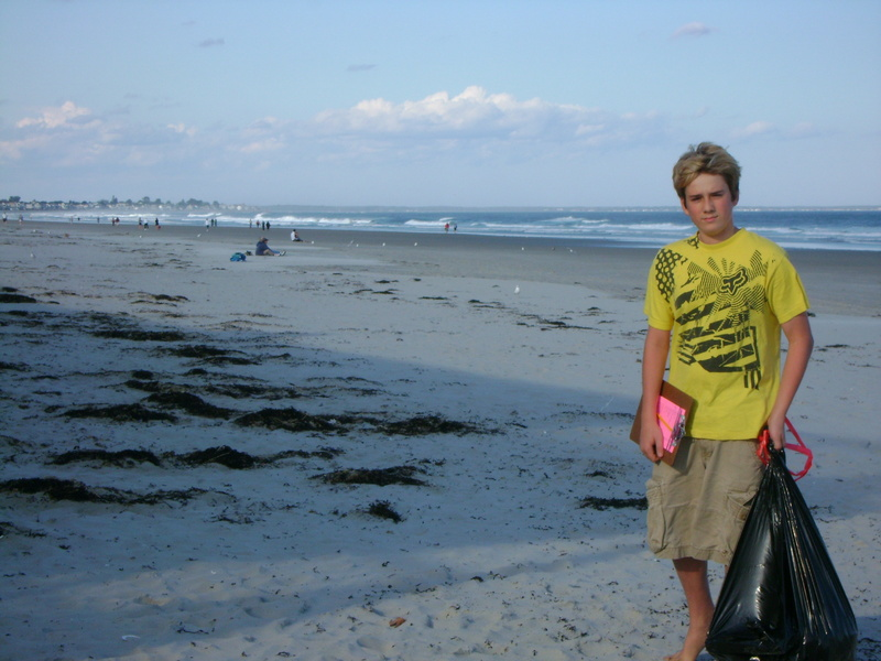 Andrew Hayford, 16, of Cape Neddick collects trash and records his findings during the 2009 International Coastal Cleanup in Ogunquit. Hayford has received a grant to fund an anti-litter campaign for southern Maine beaches.
