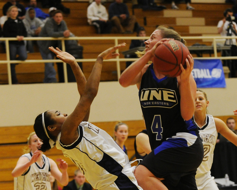 Carrie Bunnell drives to the basket Friday during the University of New England's 59-41 loss to Western Connecticut State in the opening round of the NCAA Division III tournament at Brunswick. Bunnell led UNE with 10 points.