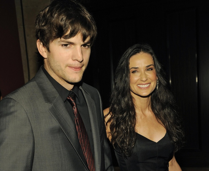 Demi Moore, pictured with husband Ashton Kutcher Thursday. Moore's Twitter account was linked to a chain of posts that led police to a man threatening to commit suicide.