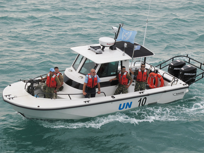 A United Nations Police patrol boat arrives at the Sea Hunter's anchorage this morning to provide security while the ship offloads its relief supplies.