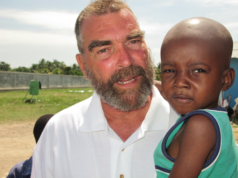 The Rev. Marc Boisvert holds Stanley Toussiant, one of almost 800 orphans who live at Hope Village in Haiti. Boisvert, a Lewiston native, founded and operates the orphanage and community assistance program on the outskirts of Les Cayes.