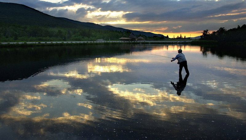 A fly fisherman tries his luck at Saco Lake, the headwaters of the Saco River. Gregory Rec Saco river Source to sea