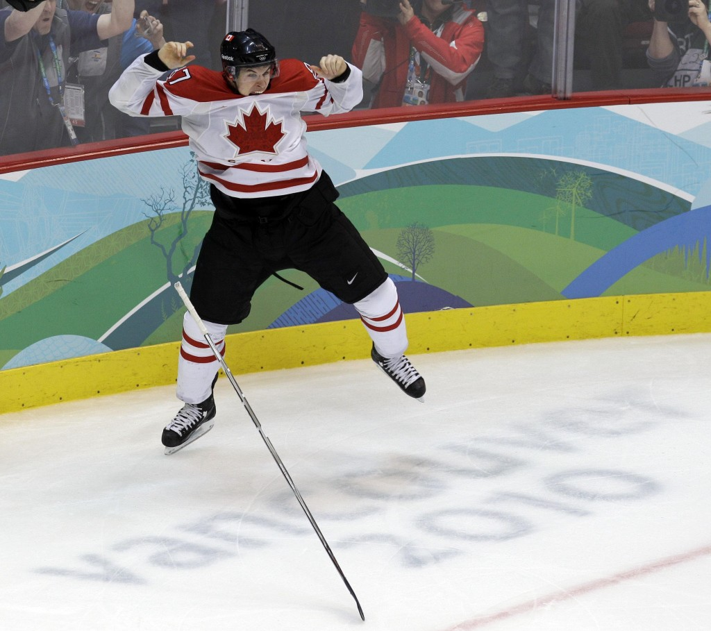 Sidney Crosby leaps for joy after stuffing a pass from Jarome Iginla through the pads of U.S. goalie Ryan Miller in overtime to give Canada a 3-2 victory and a gold medal in men's hockey Sunday on the final day of the Vancouver Winter Olympics.