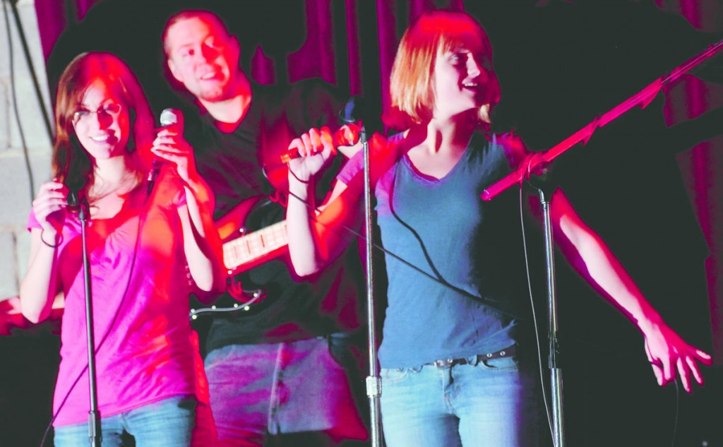 Sarah Fortin, left, of Orono and Rebecca Ewald of Portland sing with the band Trainwreck including Keith Mann, center, playing the bass, on a Wednesday at Empire Dine and Dance in Portland.