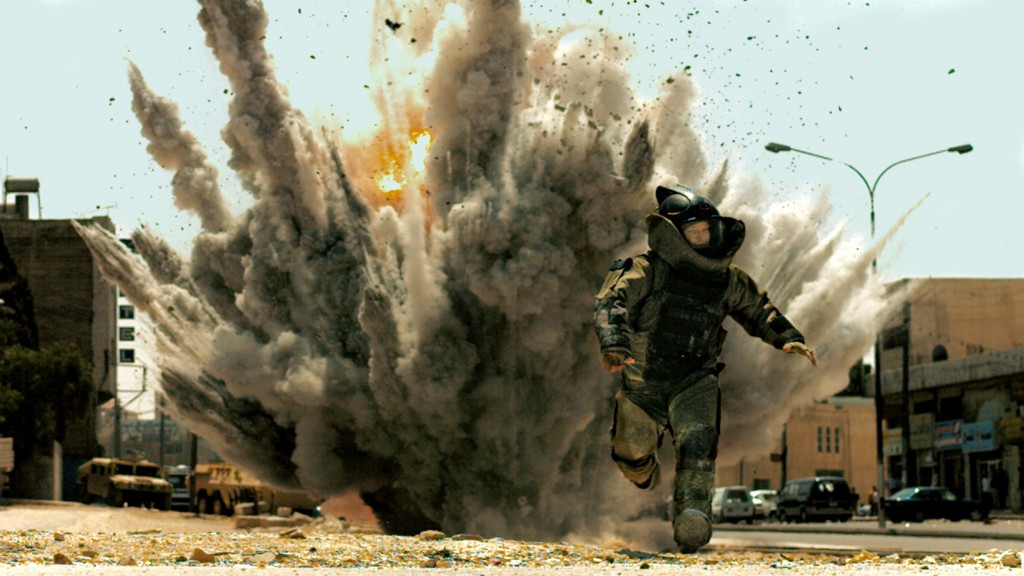 "FICTION: In a scene from ""The Hurt Locker"" Jeremy Renner, playing a swaggering bomb technician, narrowly escapes an explosion. Explosives experts say a team leader's first priority ""is getting his team home in one piece."""