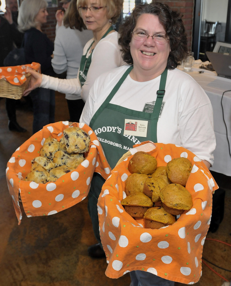 Terry McGrath of Moody's Diner in Waldoboro shares blueberry and pumpkin nut muffins at the Maine Restaurant Week event.