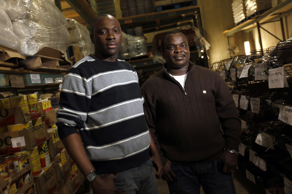 Charles Chiefredo and Adebayo Mafe own BCS African Wholesale Food Supply in Brooklyn Park, Minn. The import company was able to obtain a $67,000 loan from the nonprofit Metropolitan Economic Development Association.