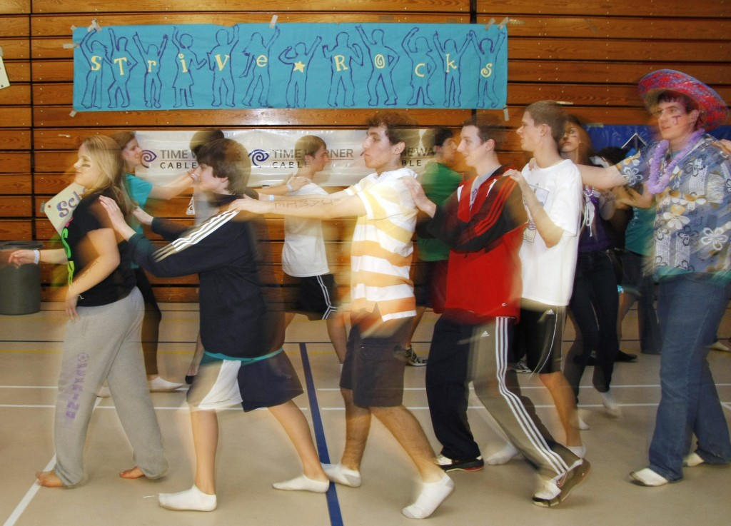 Dancers form a conga line during the final minutes of the STRIVE dance marathon Sunday.