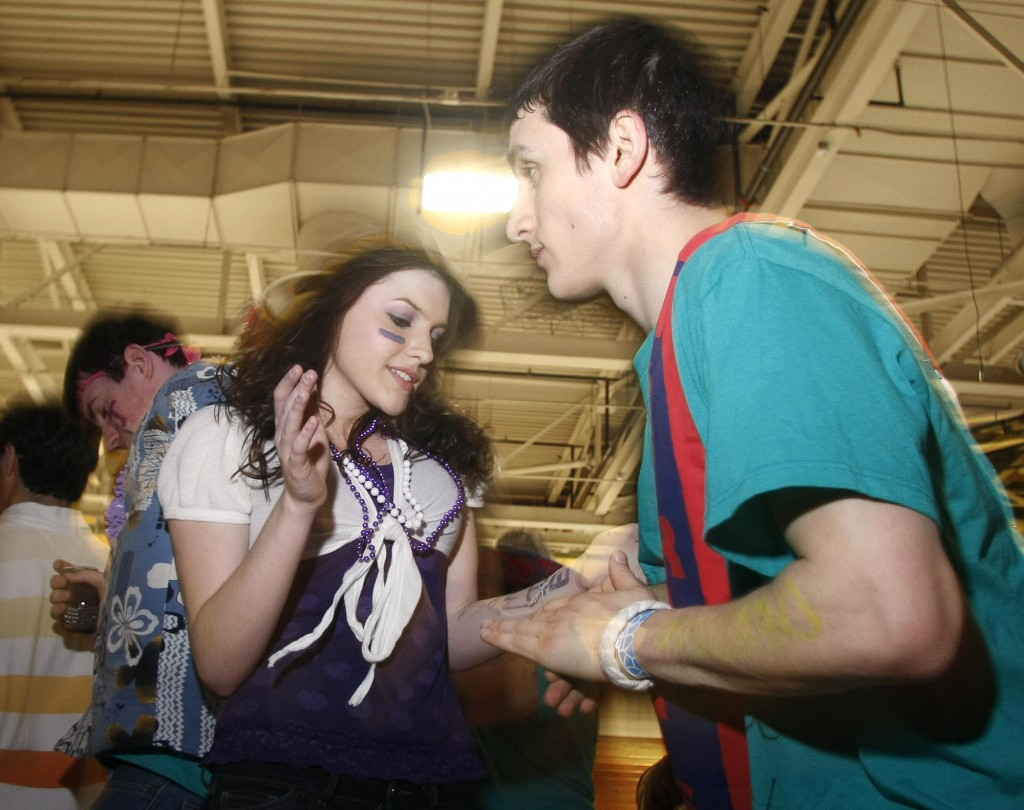 Caitlin Very and Arjan Nekoie, both Deering High School students, move to one of the final songs Sunday after dancing all night at USM's Sullivan Gymnasium in Portland at the 6th annual Dance Marathon to raise funds for STRIVE programs.