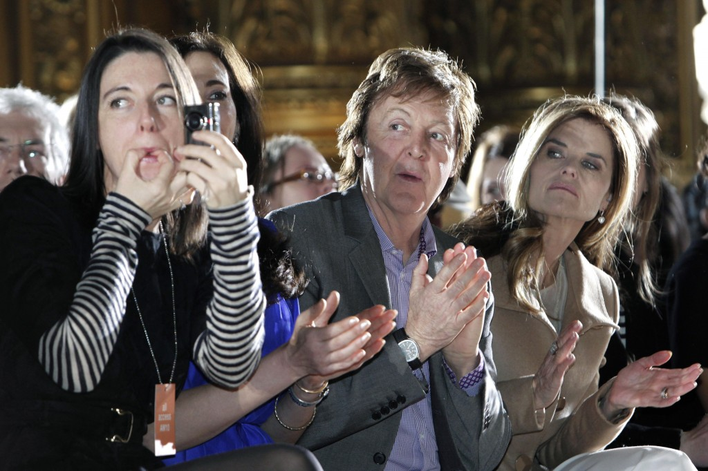 Paul McCartney and his daughter Mary attend a fashion presentation by his other daughter, Stella, in Paris on Monday. Stella McCartney launched her own collection in 1997. At right is Maria Shriver, California's first lady.