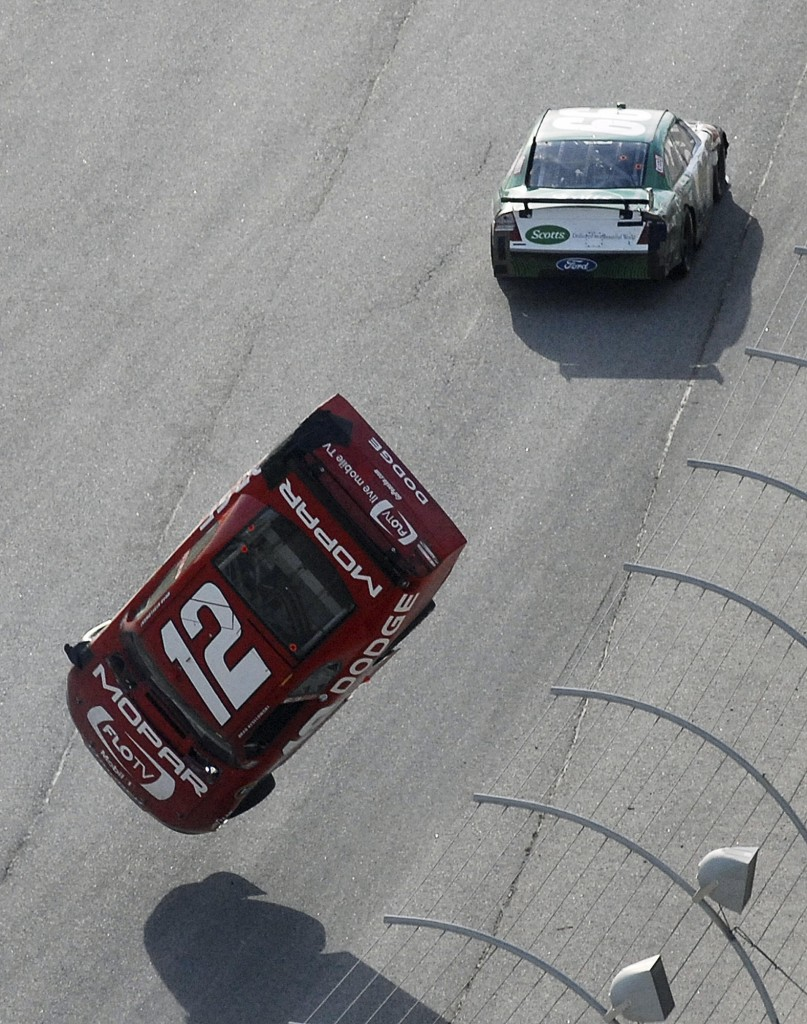 Carl Edwards drives on past after an intentional nudge that sent Brad Keselowski into a spectacular flip that endangered the driver and fans alike after the No. 12 hit the wall.