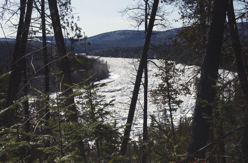 Clogged with ice, the St. John River flows through woods in the Aroostook County town of Allagash.