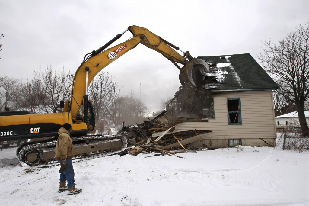Across Detroit's 139 square miles, burned-out homes such as this one are demolished or left to rot in the wake of a 50-year exodus from city limits. Factory jobs, and residents to fill them, are not coming back, so some planners call for drastic changes to the city.