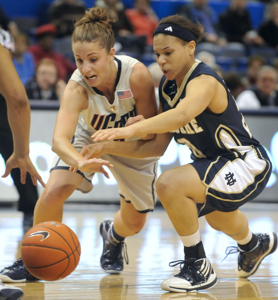 Caroline Doty, left, of Connecticut and Skylar Diggins of Notre Dame chase a loose ball Monday in the Big East semifinals at Hartford, Conn. UConn won 59-44 and will face West Virginia in tonight's championship game.