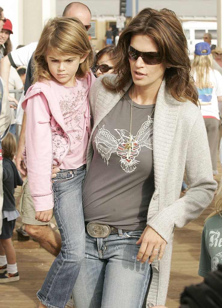 "Supermodel Cindy Crawford carries her daughter Kaya Gerber in October 2006. A photo of the bound child taken during a ""cops and robbers"" game was used in an extortion plot."