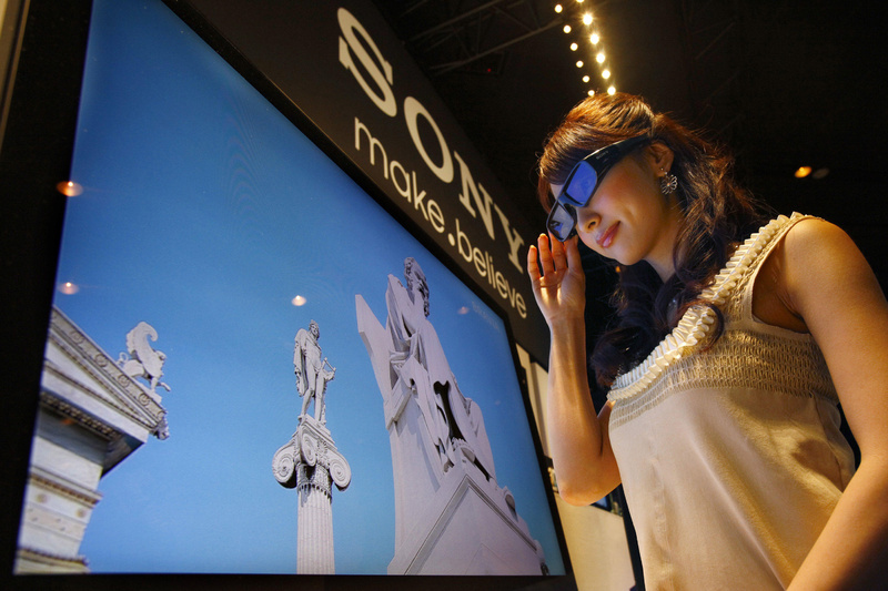The Associated Press A model wearing 3-D glasses watches Sony's 3-D television during its introduction Tuesday in Tokyo. Sony will start selling the televisions in June, joining an industry push to convince consumers to embrace the technology.